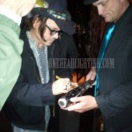 Johnny Depp signs Jackamoe's bat at Vernon's Steakhouse